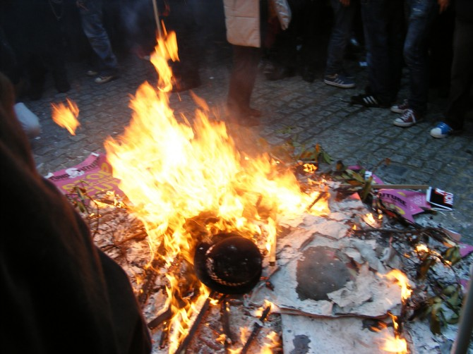 Rioters burn policewoman's hat