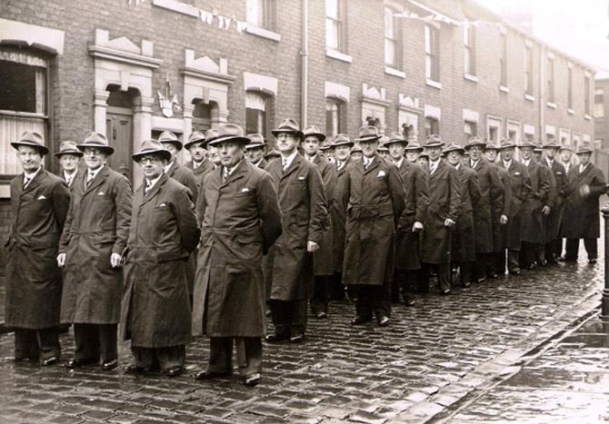 group of men celebrate 1952 Guild