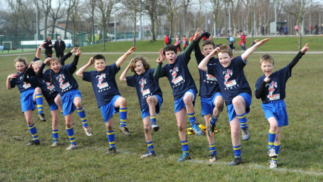 Doing the Usain Bolt: Our Lady pupils show off their moves after their win