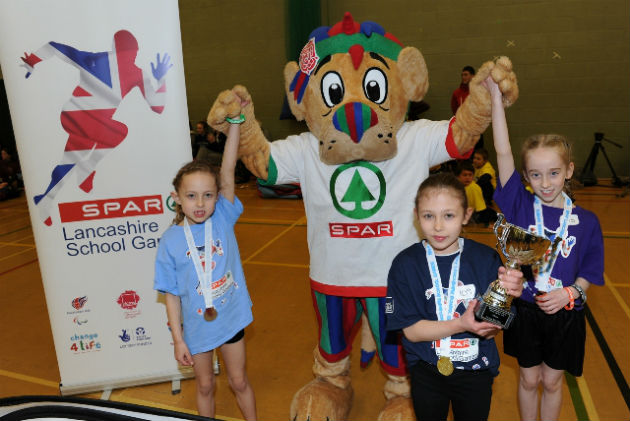 Olivia (front) with her trophy after gymnastics win