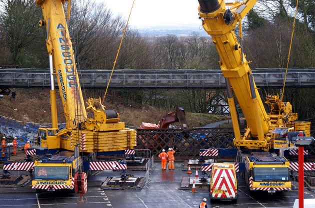 Closer view of workmen assessing the Vicars Bridge situation