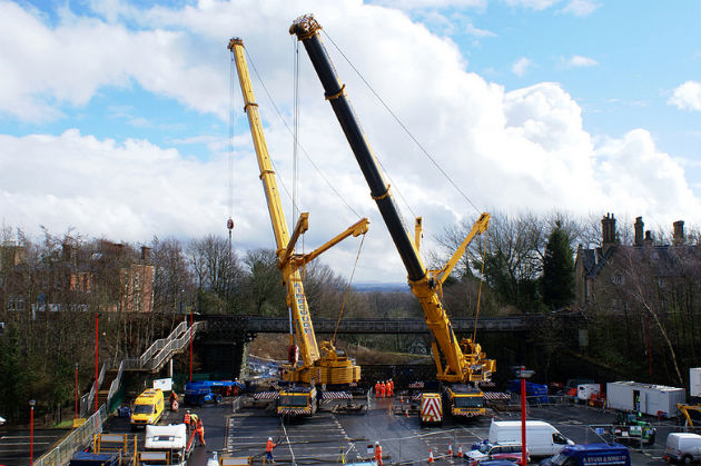 View of the cranes working to remove Vicars Bridge