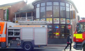 Smoke floats from Sandos after fire crews had been into the building
