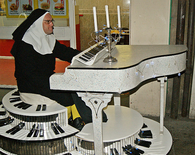 We're quite aware this a man dressed as a nun playing a piano down Church Street. It's perfectly normal. Honest.