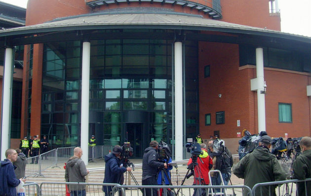 The media scrum outside the crown court as they await the families of the victims
