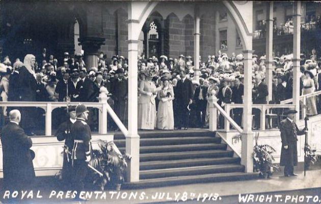 The King and Queen standing on a specially built platform at the old Town Hall