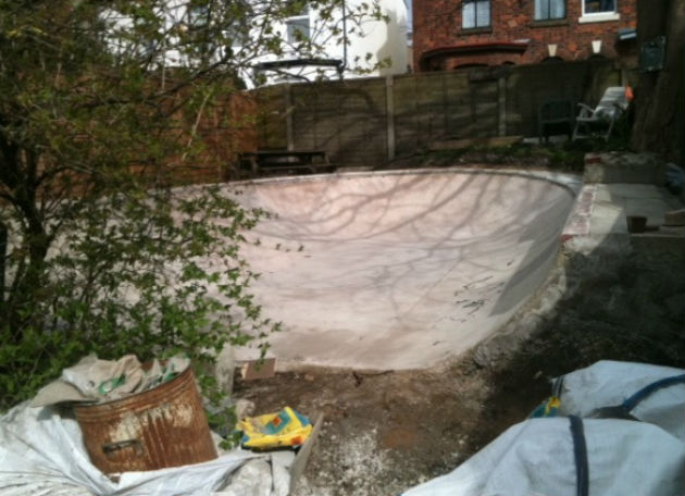 The semi-circular skate ramp in the back garden