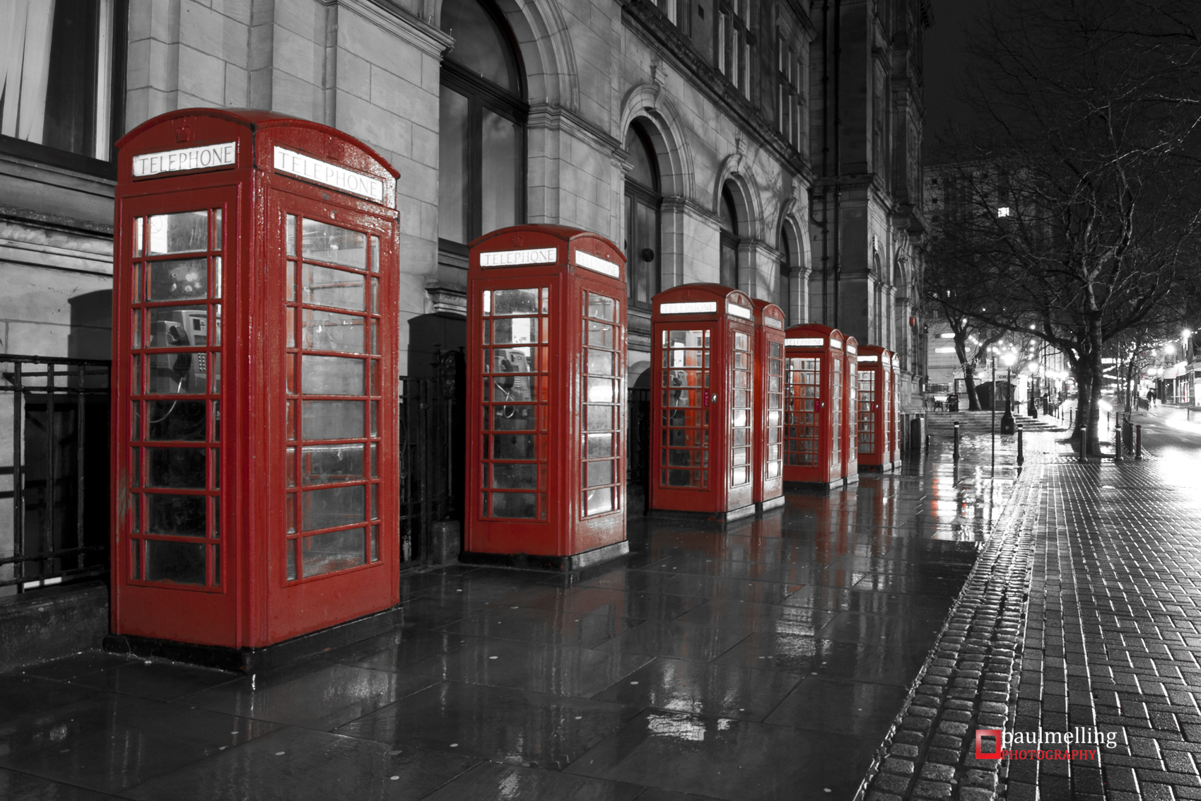 Row of traditional red telephone boxes on Market Street.