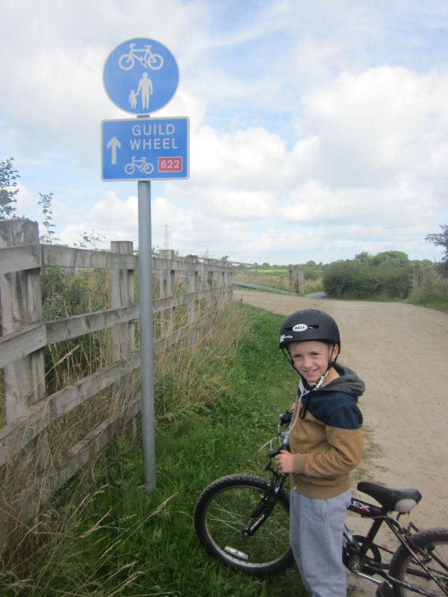 Eli poses by the Guild sign