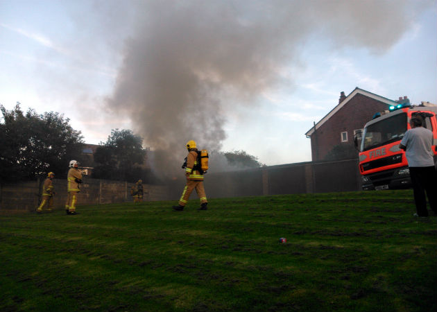 Fire crews at the garage fire in Lea. Pic by Jo Cook.