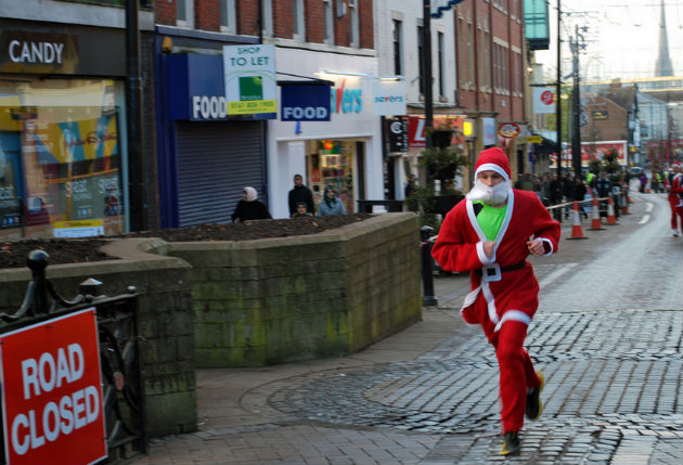 A Santa takes on last year's Dash through the city centre