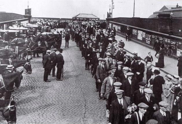 The Preston Pals queue at Preston rail station