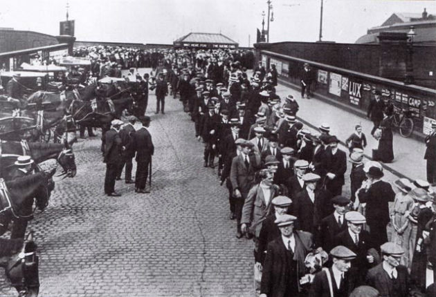 The Preston Pals queue at Preston rail station