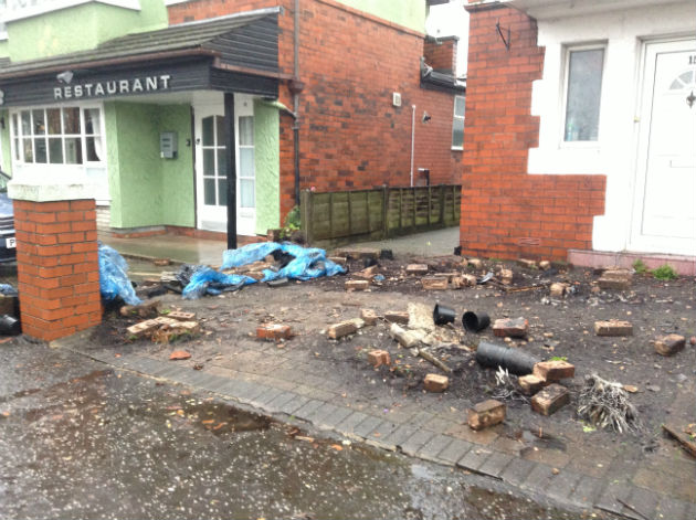 The wall of the front garden was destroyed in the incident