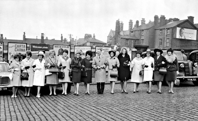 Sir Tom lines up with the PNE wives before they depart for London