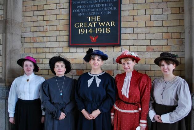 Free buffet lady volunteers stood under the Preston Pals War Memorial