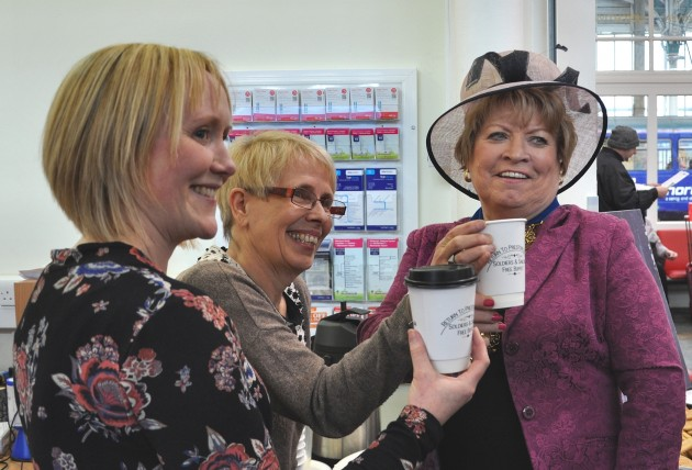 The Mayor of Preston Councillor Veronica Afrin (to the right) samples the buffet tea in one of the commemorative cups