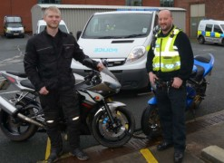 James Dilkes with PC Grundy after having his bike returned