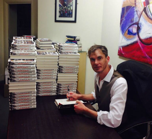 Jason Hewitt signing copies of his book