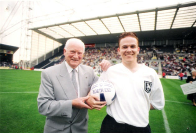 The real Sir Tom with Norman who played him in the musical during a game at Deepdale
