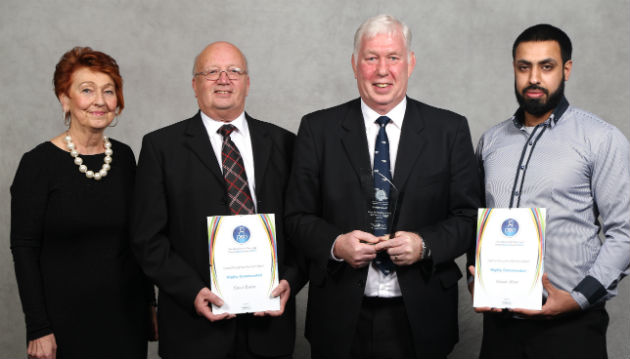 Joe Powell (second from right) collects special recognition award