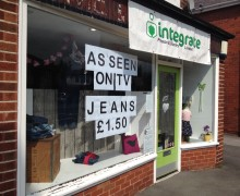 Additional signage on the Integrate charity shop on Liverpool Road