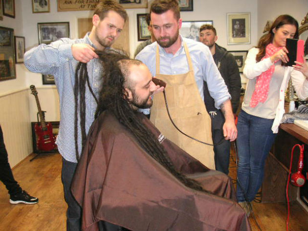 Declan and colleague part-way through the shave off