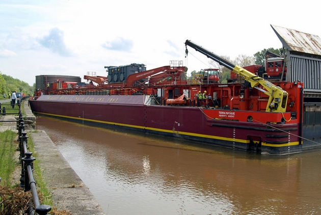 The transformer being lifted from the barge