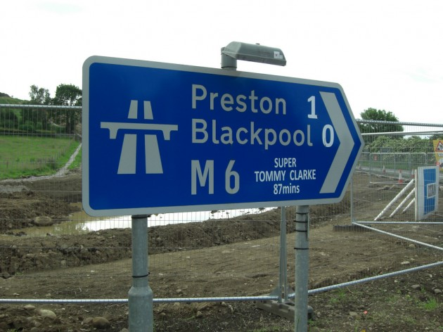 Junction 34 sign on the M6 with some modifications