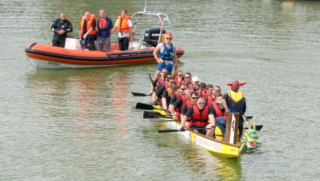 Dragon boat comes to a halt during the race on the Docks