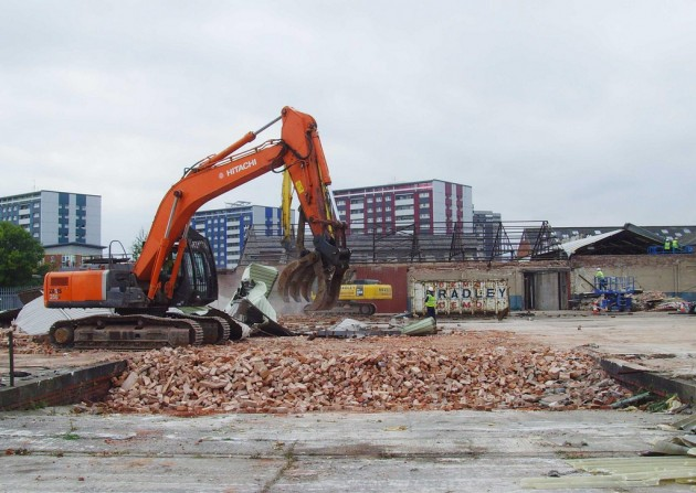 Bulldozers in 2009 working on the site of the former Booths distribution depot