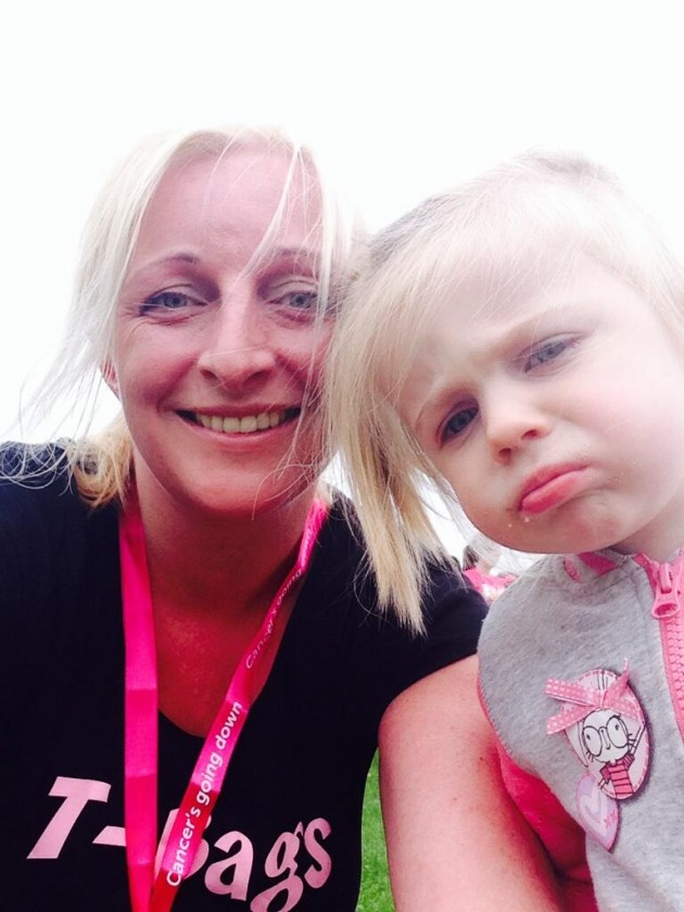 Charlotte and daughter pose after the race