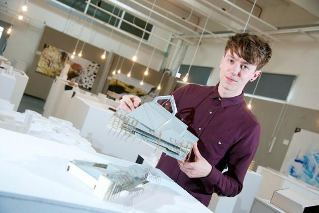 Alex Macbeth shows off his work