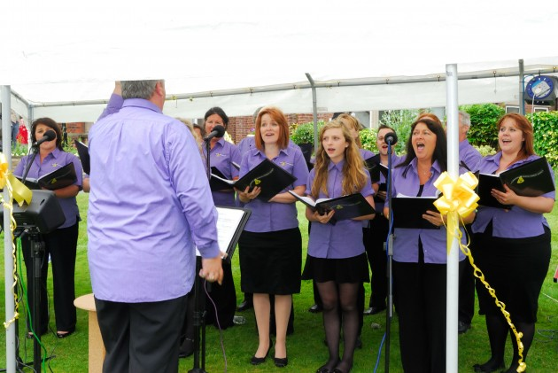 Singing during last year's fete