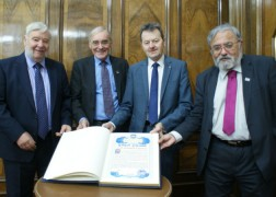 Ken Hudson, Bill Shannon, Carl Crompton and Jonathan Saksena with the Guild Book