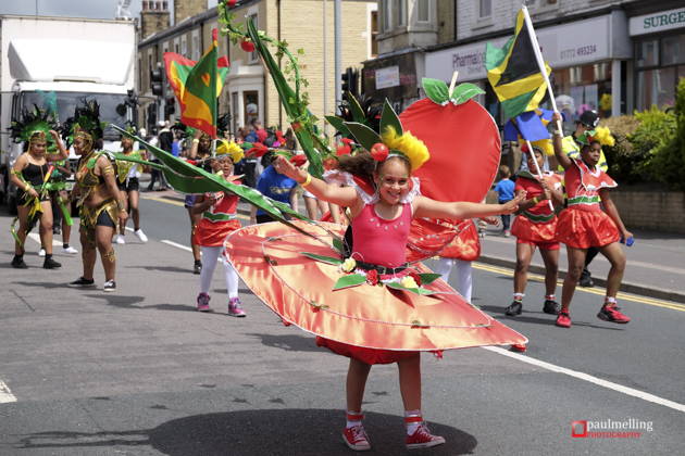 Preston, UK. 21st June 2015. Thousands join in Preston's Carib