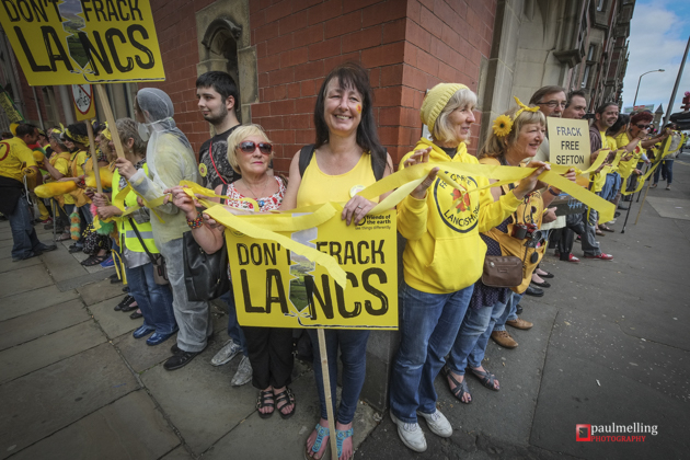 Anti-Fracking demonstrators from across the UK circle the headquarters of Lancashire County Council. Councillors are debating whether to give the go-ahead to two applications to Frack in the County by energy firm Caudrilla