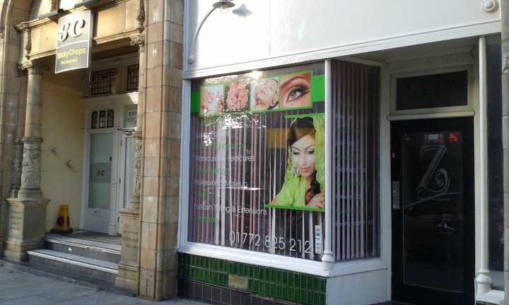 The beauty salon and current restaurant both have damage to their windows