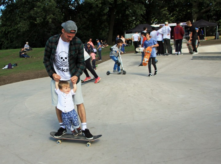 A young skater gets a helping hand from his father Pic: Jim Beattie