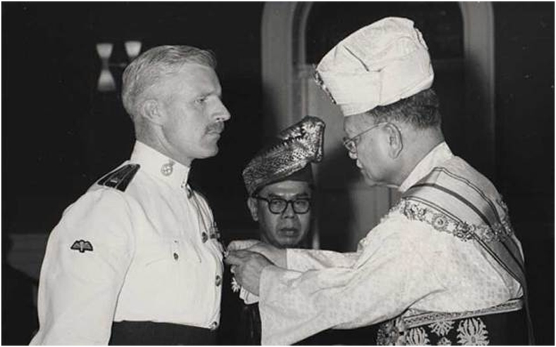 Being awarded the Ahli Mangku Negara by the King of Malaya in Kuala Lumpur in 1959