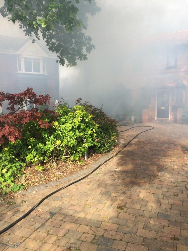 Smoke billows around Mossbrook Drive