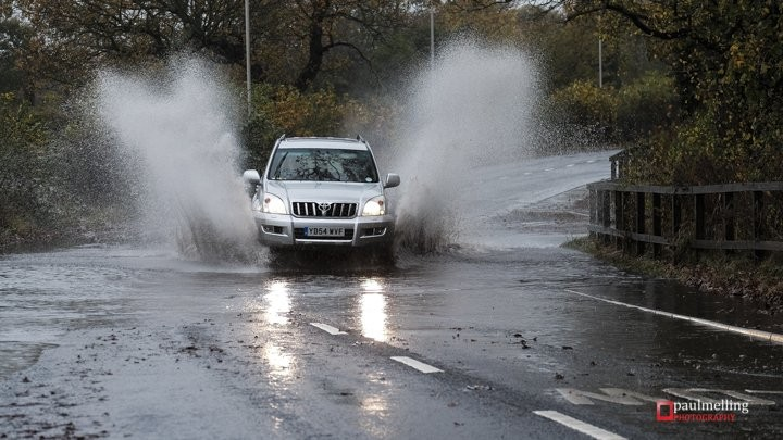 A car passes through standing water in Lea Pic: Paul Melling