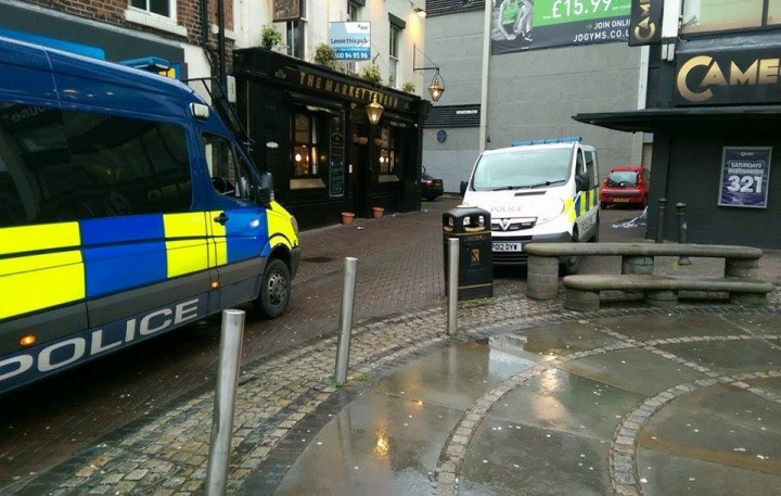 Police vehicles near the Market Tavern pub