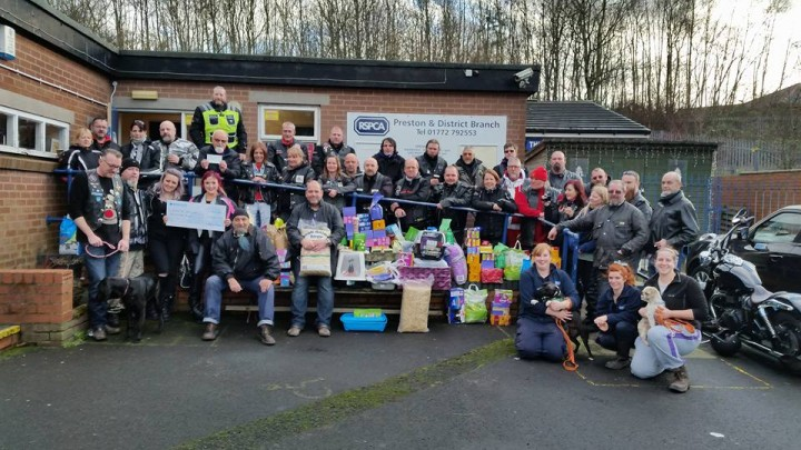 Bikers with RSPCA staff and volunteers and the supplies donated