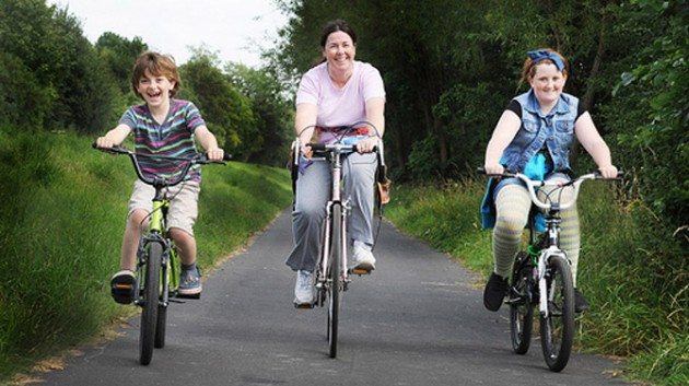 a family enjoy cycling the guild wheel