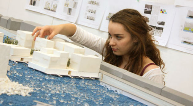A student with the scale model of Preston Docks
