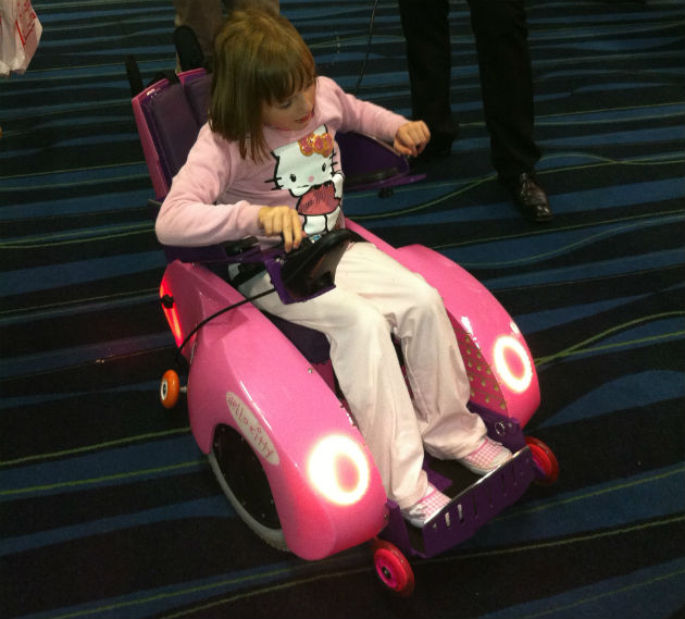 Evie tries out one of the mobility chairs