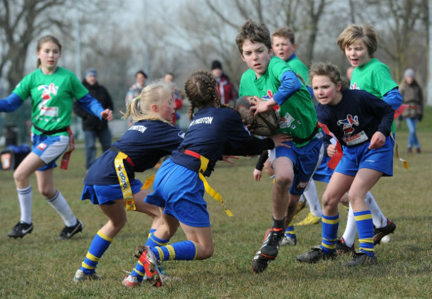 'av 'im ladies! Preston girls go in for the tackle during tag rugby final