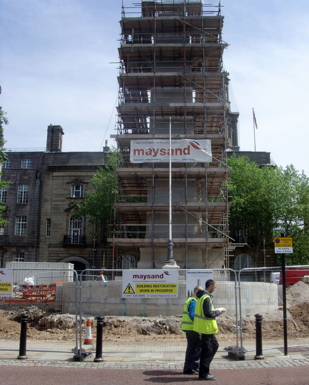 Scaffolding surrounds the monument on the Flag Market