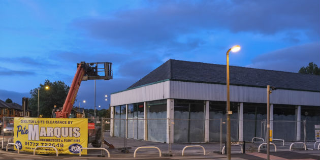 The demolition crews are in the remove the former car showroom